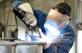 Image of man welding