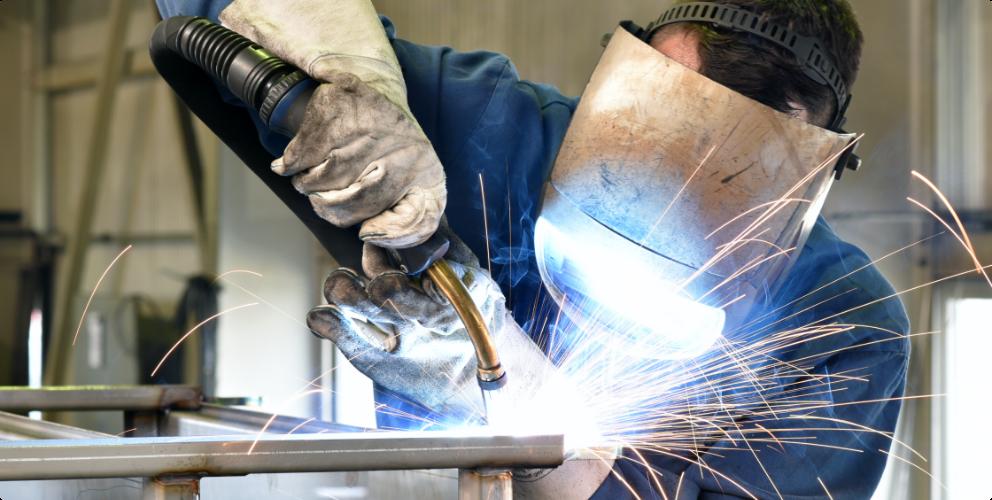 Image of man welding
